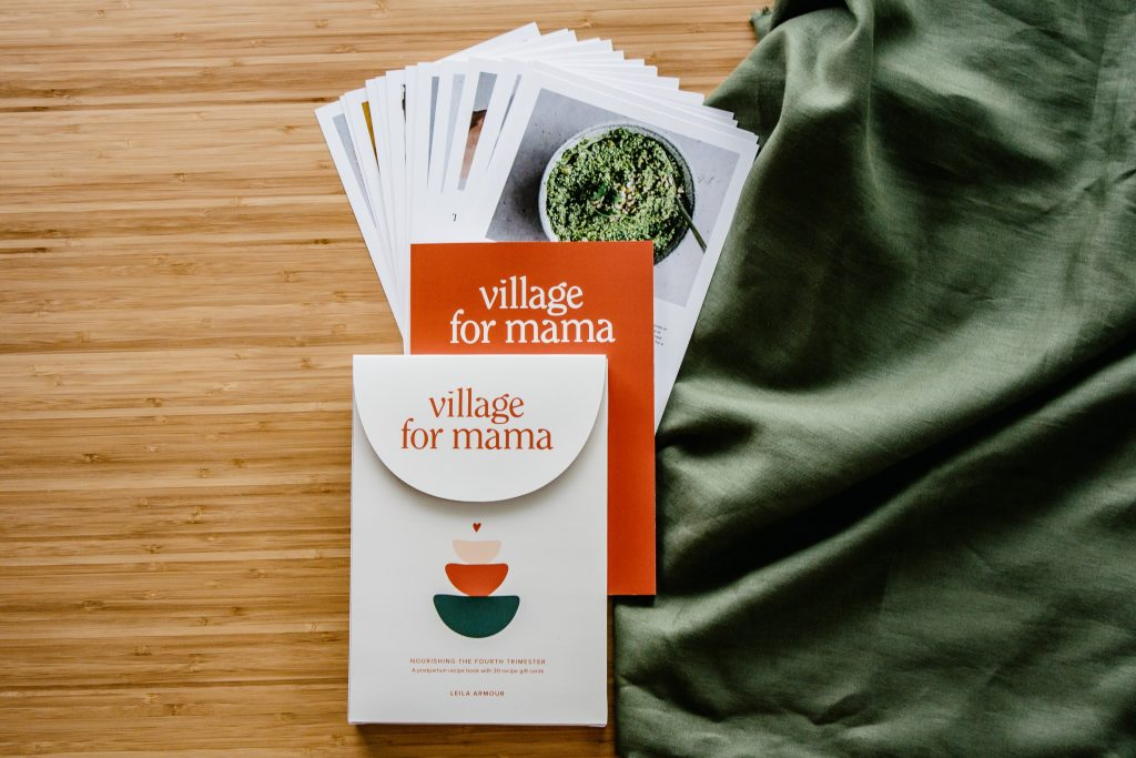 village for mama box, book and cards